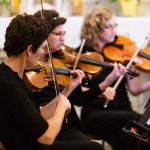 Photo of string quartet playing in church